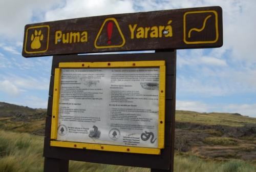 Park Sign Warning Visitors to be on the Lookout for Puma and Vipers